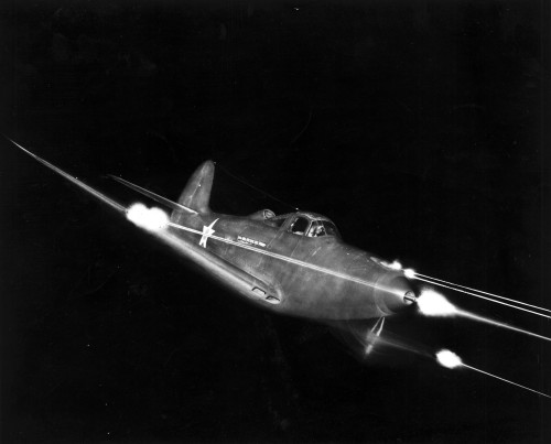Bell_P-39_Airacobra_in_flight_firing_all_weapons_at_night